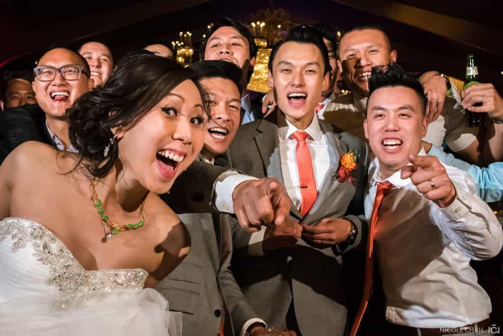 Danversport Yacht Club Asian outdoor wedding. Wedding couple photos at Christopher Columbus Park near Boston waterfront harbor