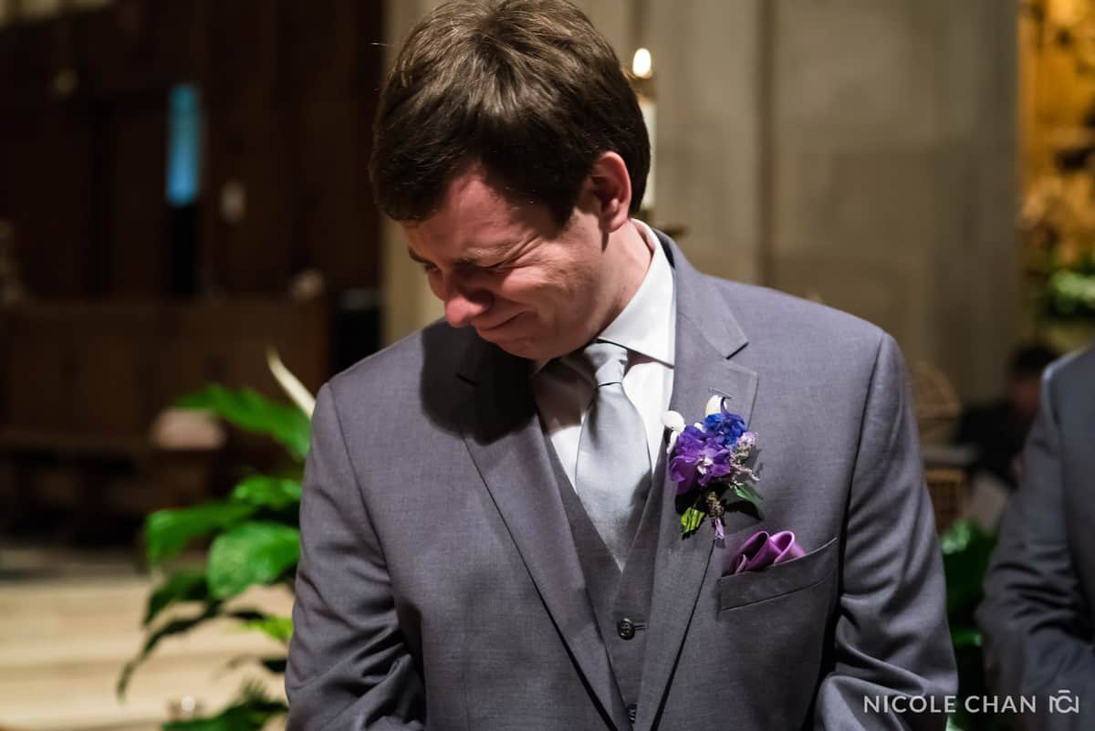 Emotional groom watches his bride walk down the aisle at St. Ignatius Parish, on Boston College's Campus