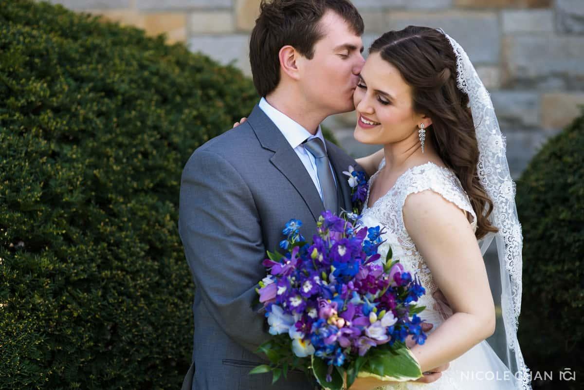 Emotional bride and groom at St. Ignatius Parish wedding, on Boston College's Campus