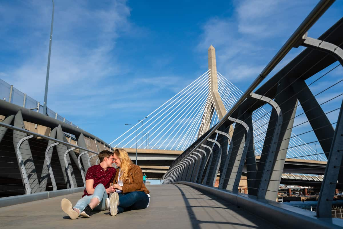 couple posing for engagement session photos in north point park in cambridge by nicole chan photography